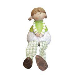 Zöld ruhás, lógó lábú lány